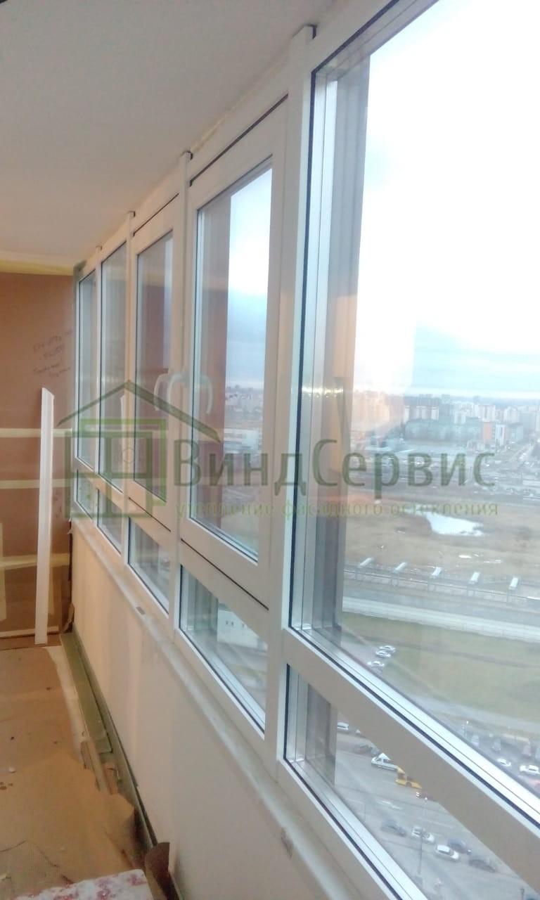 Витражное остекление балкона. Федора Абрамова 4 ЖК Северная долина